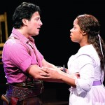 Nicholas Rodriguez as Curly and Eleasha Gamble as Laurey in 'Oklahoma!' at Arena Stage's new Mead Center for American Theater. Rodriguez, who's gay, is entirely convincing as a straight character and generates genuine chemistry with Gamble. (Photo by Carol Rosegg; courtesy of Arena.)