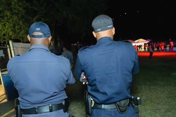 Two police officers stand outside a Pride party in Kingston, Jamaica, on Aug. 5, 2015. Consensual same-sex sexual relations remain criminalized in the country, but LGBT rights advocates have become more visible in recent years in spite of persistent violence and discrimination. (Photo courtesy of J-FLAG)