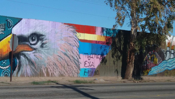 Murals on a wall that marks the U.S.-Mexico border in Mexicali, Mexico. (Photo courtesy of Victor Aguirre)