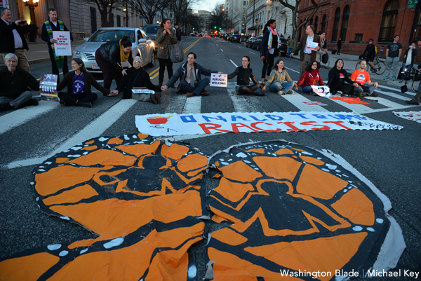 Protesters who oppose President Trump's executive orders to curb immigration sit in 15th Street, N.W., near the White House on Jan. 25, 2017. (Washington Blade photo by Michael Key)